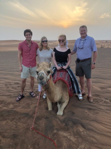 Riding a camel with the family in the Arabian Desert!